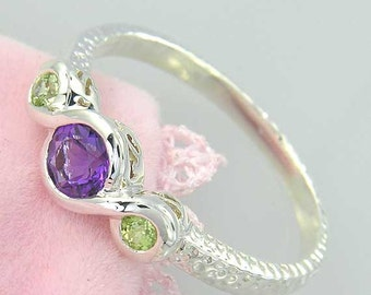 Amethyst and Peridot Sterling Ring. Purple Amethyst and Green Peridot 3 stone Ring in 925 Sterling Silver. Hammered Finish.