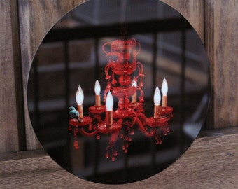 """Crimson Perch-----An Illustration of a teal bird perched upon a red crystal chandelier Infused onto a 5x5"""" High Gloss Metal Circle"""