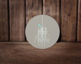 PRETTY classy BIRD-An Illustration of a teal bird perched upon a white chandelier Infused onto a high gloss metal circle