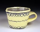 Yellow and Gray Ceramic Cup