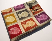 Netbook cover, handmade from striking postage stamp fabric - made to order