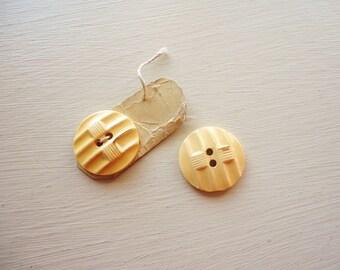 pair of cream vintage bakelite buttons
