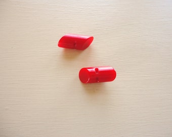 set of two red bakelite toggle round buttons