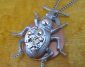 Steampunk necklace cyber bug scarab beetle with jeweled watch movement handmade by Steampunk Supply Shop