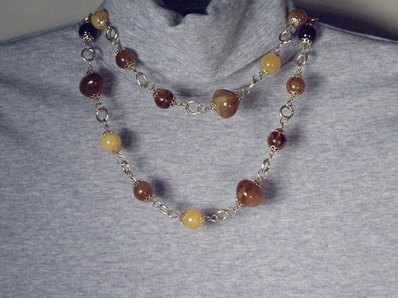 """Necklace with multi colored brown and gold beads, 39"""" long"""