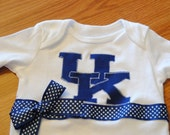 Variety of Teams Available. University of Kentucky Ribbon bodysuit/infant one piece or Shirt