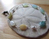 Beautiful light opal and sterling silver bracelet, with tourmaline charms