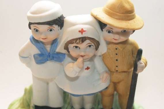 "Vintage Porcelain Music Box Collectible, Old Fashion Nurse, Sailor and Soldier, ""God Bless America"""