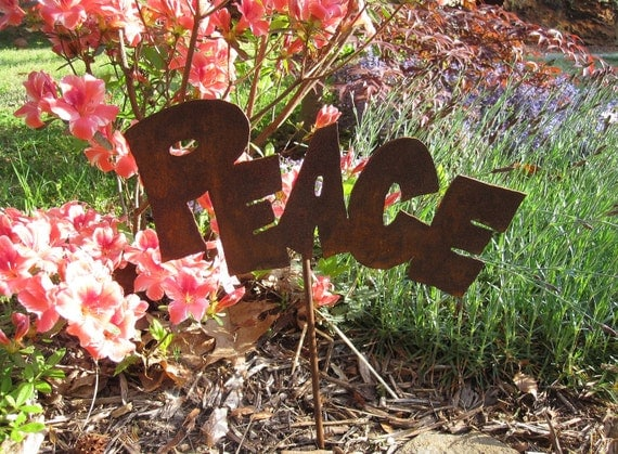 """Metal """"Peace"""" Sign for the Garden."""