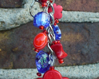 Beaded keychain, purse charm. Made with Red and Blue Glass Beads, Red Turquoise Bead Frame.
