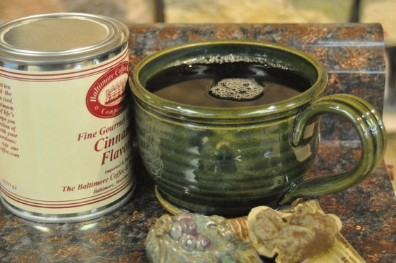 """Stoneware Pottery Cup with Forest Green Glaze. 3"""" tall x 4-1/2"""" dia. Holds 16 ounces of your favorite beverage."""