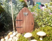 Miniature Fairy Door faux wood finish with a butterfly charm to dress it up