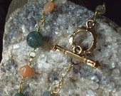 Green moss agate and peach moonstone wire wrapped toggle bracelet