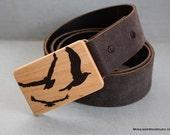 Black epoxy resin flying birds inlay on maple belt buckle