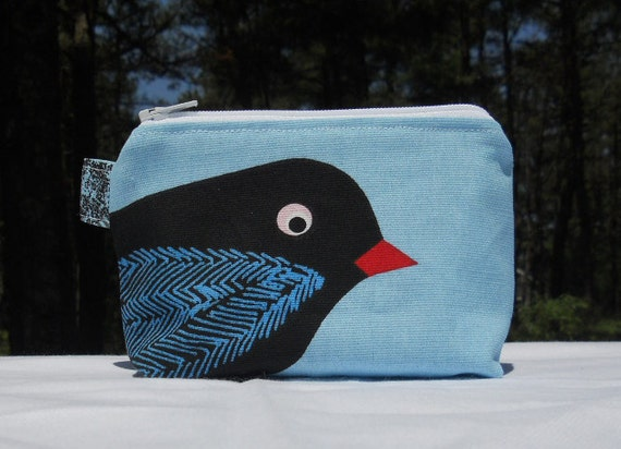 Small blue canvas cosmetic bag, black bird with blue wing
