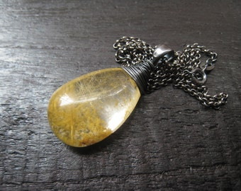 Rutilated quartz pendant,oxidized sterling silver