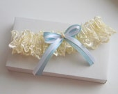 Ivory Wedding Garter with blue and white bow