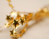 1 yard - Cute little metallic gold star ribbon