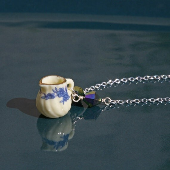 SALE! Doll's jug necklace: Pretty necklace handmade with a dolls milk jug charm, vintage beads, sterling silver