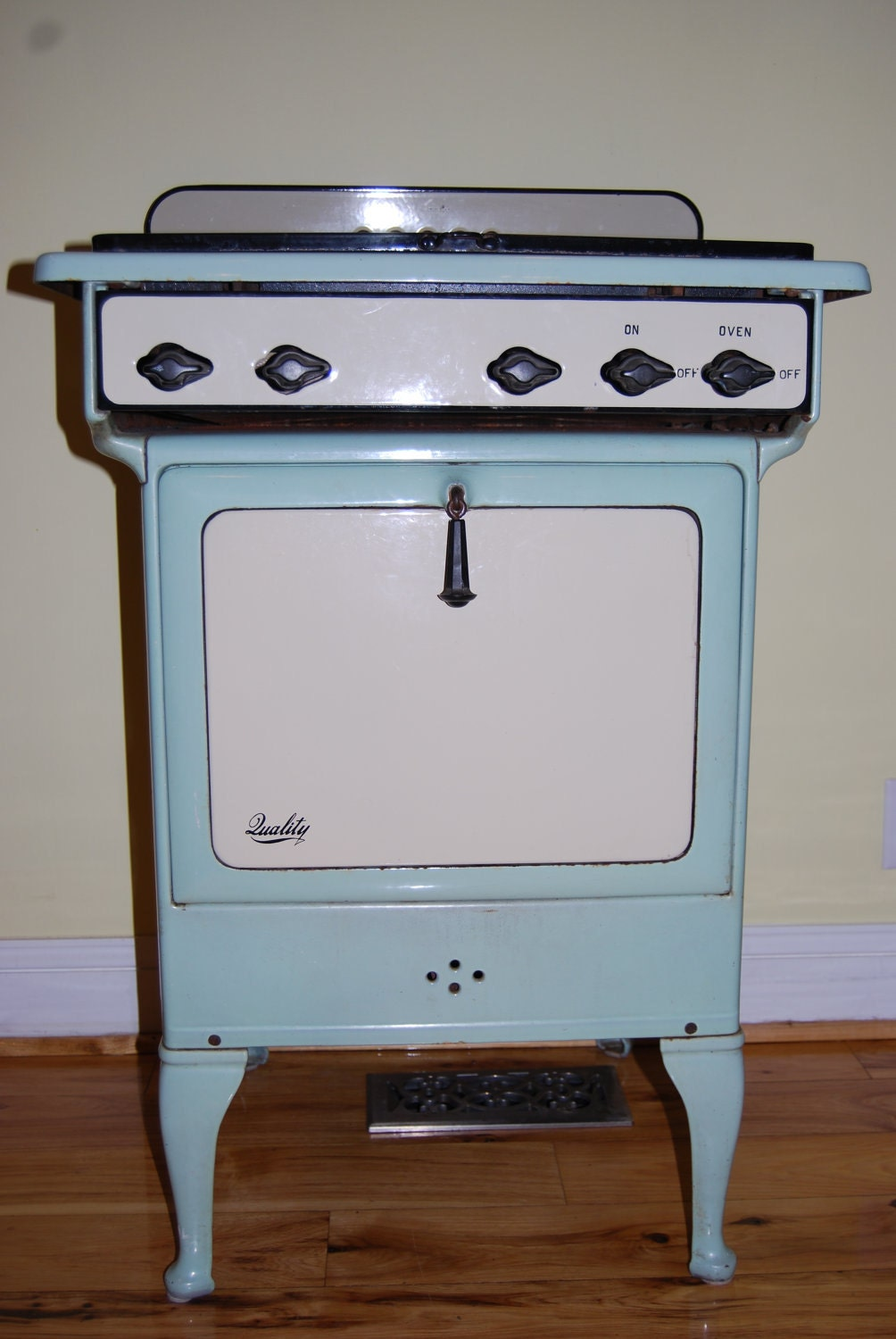 vintage enameled gas oven stove in mint green by