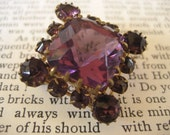 Victorian amethyst glass and brass c clasp brooch
