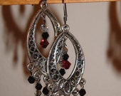 Chandelier earrings with Red, black, and silver crystals, with silver filigree component.