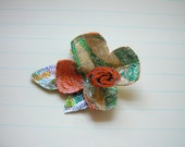 upcycled wrapper bags and fleece flower brooch
