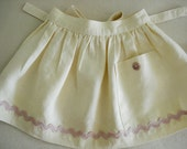 Full gathered, half APRON, 100%  Linen, pale yellow , dusty rose rickrack and pale pink natural shell button details