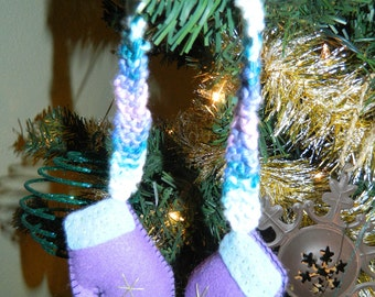 "Cute purple mitten stuffies with attached ""scarf"" for hanging as a winter decoration"