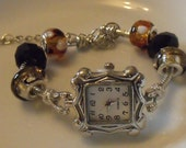 Charm style bracelet watch with beautiful beads