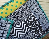 Quilted potholders, green, teal, and black
