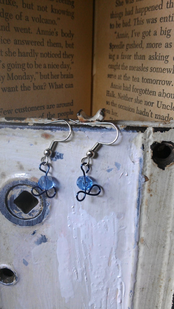 Blue Copper Wire Wrapped Infinity Symbol w/ blue see thru bead and silver ear wigs