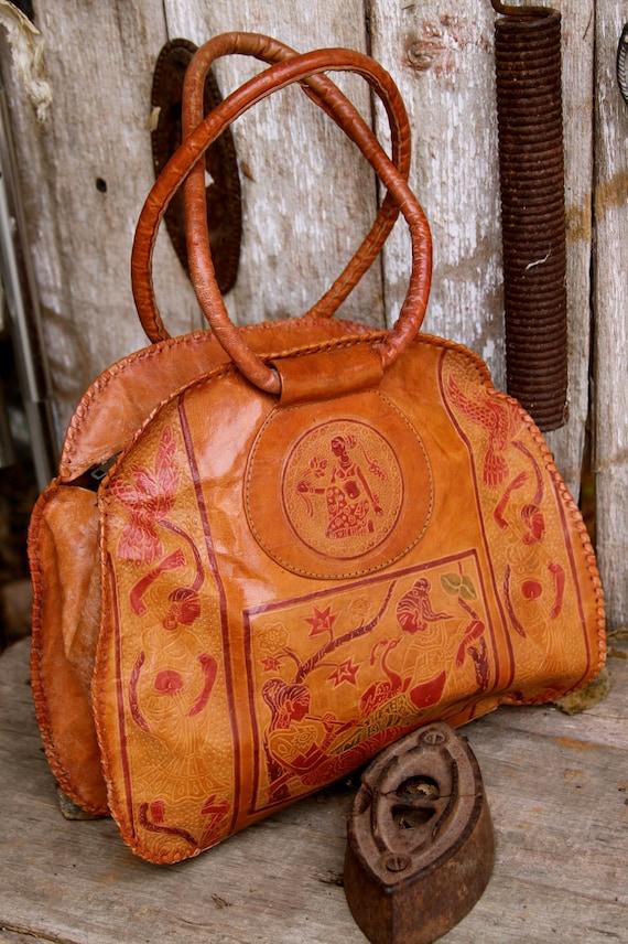Vintage leather Handbag .Indian women engraved .1970s