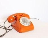 Vintage rotary telephone tangerine tango