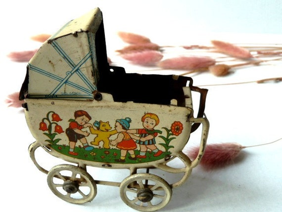 Antique french doll baby cradle .  Tin Baby Carriage .Toy .1900s
