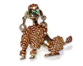 Poodle brooch with emerald green rhinestone eyes and swinging faux pearl earrings animal