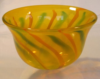 """Hand blown """"old gold"""" glass bowl with orange and green stripes"""