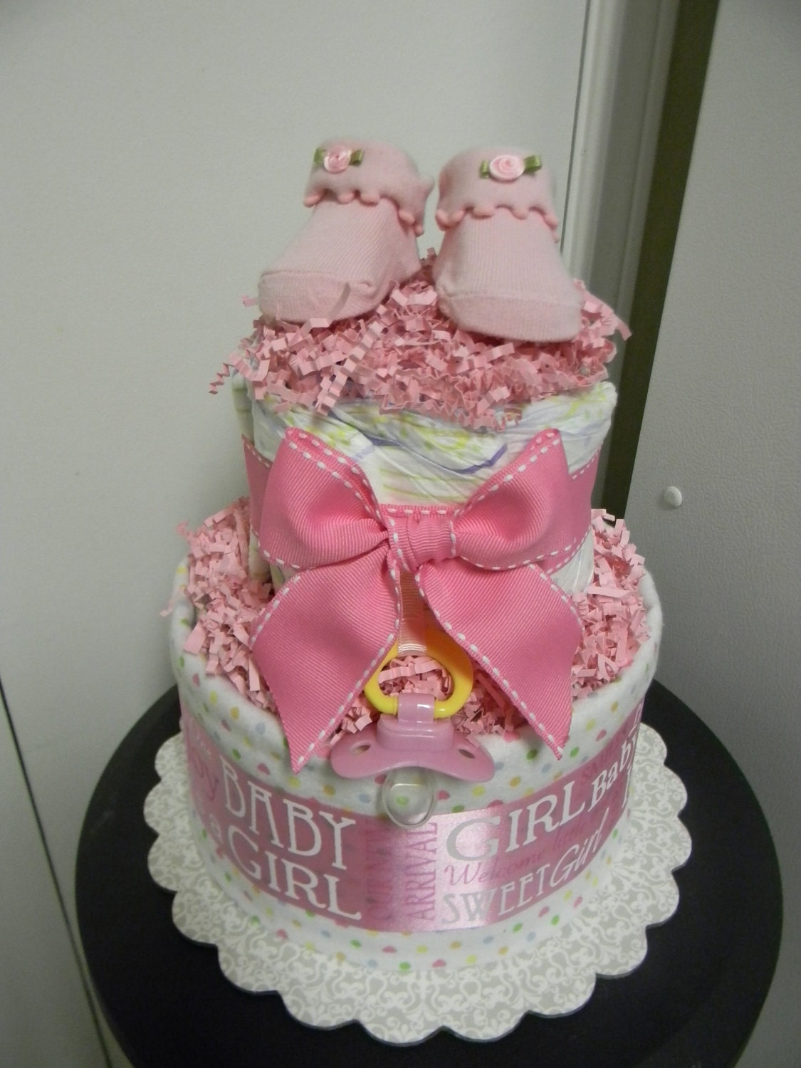 Baby girl loaded 2 tier diaper cake baby shower centerpiece for Baby shower decoration ideas with diapers