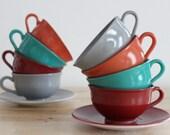 1940s Platonite Teacups -  Hazel Atlas Ovide Dinnerware Cups and Saucers in Teal, Grey, Red and Orange