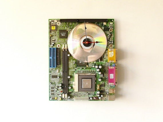 Wall clock made from a recycled Computer green circuit board
