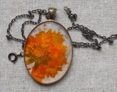 pressed flower necklace handmade resin jewelry natural botanical wildflower vibrant orange autumn fall coreopsis daisy flower cottage garden