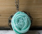 sweet fabric rosette necklace on a filigree setting - charming shabby chic whimsical garden flower - turquoise blue fabric