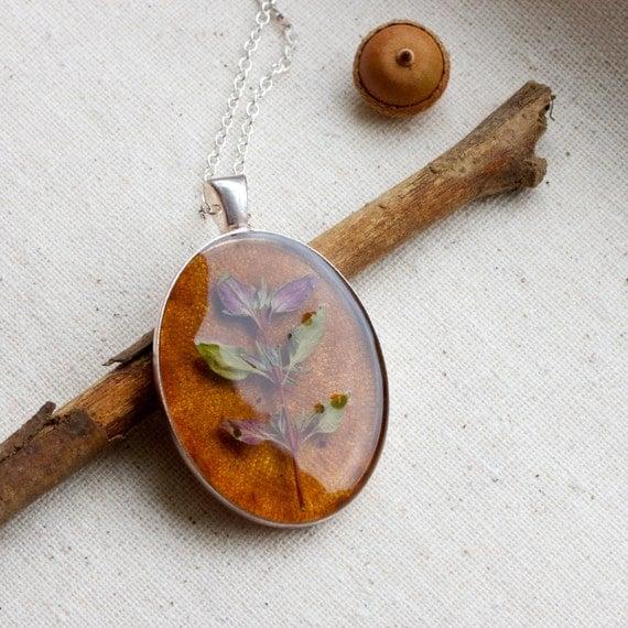 botanical pressed herb necklace on patina kraft paper. fresh spring summer garden handmade resin jewelry romantic delicate pendant
