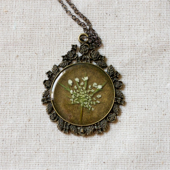 pressed flower necklace resin necklace dried queen annes lace set in resin. shabby chic circle filigree pendant for summer. prairie.
