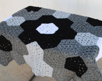 Crocheted baby afghan in Black & grays with matching beanie and booties.