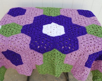 Crocheted Flower baby afghan in purples with matching beanie and booties