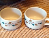 Trend Syracuse china cups, leaf design, with and without handle, pair