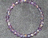 bracelet with purple AB crystals on memory wire