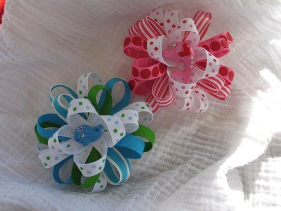 Blue, green and white loopy hair bow with whale and pink, red and white loopy hair with pink and red dolphin