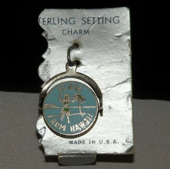 Sterling Enamel Spinner Charm on the original card